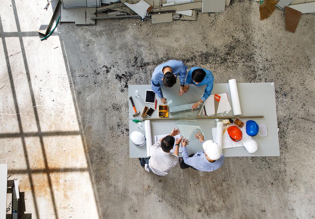 Project portfolio management team meeting around a desk